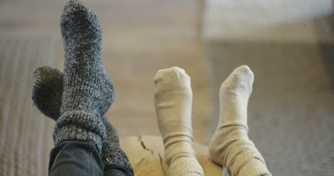 Low-Section-Of-Family-Wearing-Socks-At-Home