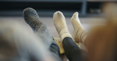 Young-Couple-Wearing-Socks-At-Home-1