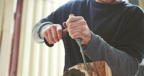 Man-Working-With-Wood-With-Chisel