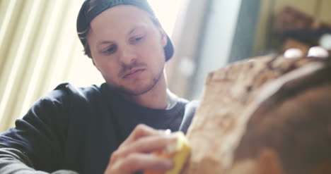 Carpenter-Shaping-Wood-With-Chisel