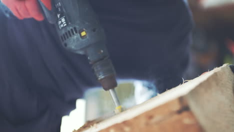 Carpenter-Drilling-In-Wood-