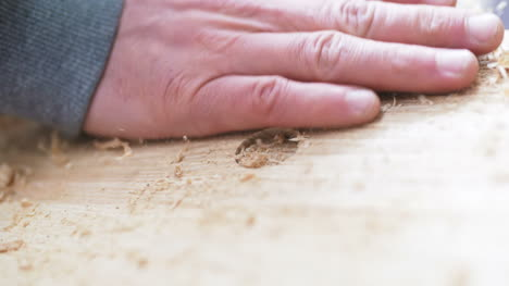 Diy-Background-Satisfied-Man-Dusting-Wood-Shavings-In-Workshop