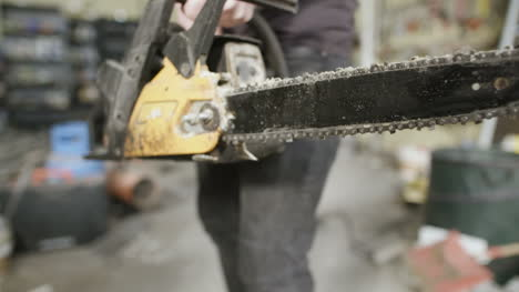 Young-Craftsman-Starting-Powered-Chainsaw-In-Workshop-1