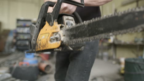 Young-Craftsman-Starting-Powered-Chainsaw-In-Workshop-2