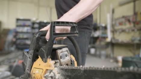 Young-Craftsman-Starting-Powered-Chainsaw-In-Workshop-3