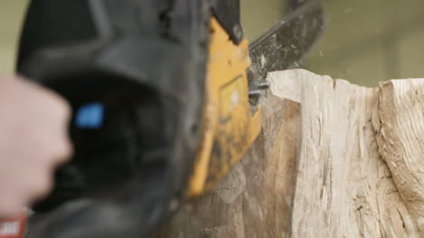 Cutting-Through-Wood-With-Chainsaw-In-Slow-Motion-