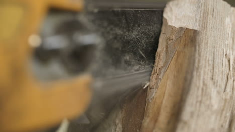 Cutting-Through-Wood-With-Chainsaw-In-Slow-Motion-2