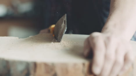 Carpenter-Cutting-Wood-With-Handsaw-In-Workshop-2