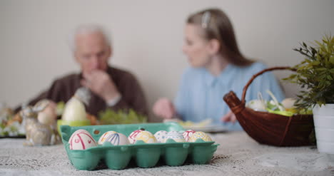 Happy-Easter-Senior-Man-Eating-Easter-Holiday-Breakfast-With-Granddaughter-