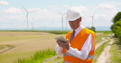 Engineer-Using-Digital-Tablet-At-Windmills-Farm-3