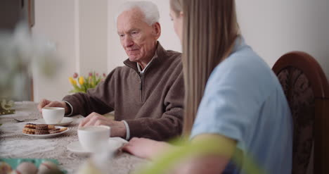 Happy-Easter-Grandfather-And-Granddaughter-Spending-Easter-Together-Talking-At-Home-1