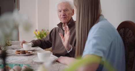 Happy-Easter-Grandfather-And-Granddaughter-Spending-Easter-Together-Talking-At-Home-2