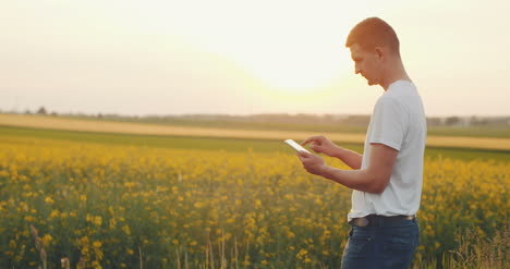 -Agriculture-Technology-Young-Farmer-Using-Digital-Tablet-