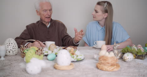 Happy-Easter-Grandfather-And-Granddaughter-Spending-Easter-Together-Talking-At-Home-4