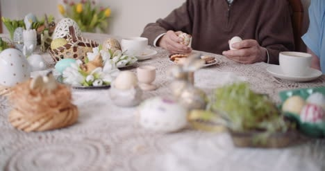 Elcerly-People-Care-Senior-Man-Holding-Easter-Eggs-In-Hands-Happy-Easter-
