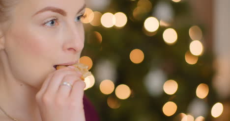 Young-Woman-Enjoying-Fresh-Baked-Cookie