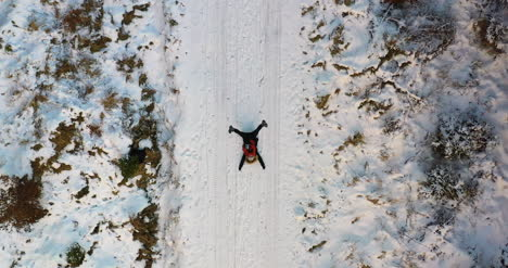 Aerial-Shot-Of-Woman-Playing-On-Snow