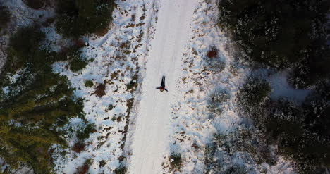 Aerial-Shot-Of-Woman-Playing-On-Snow-1
