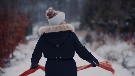 Woman-Wearing-Scarf-On-Neck-In-Winter-Outdoors