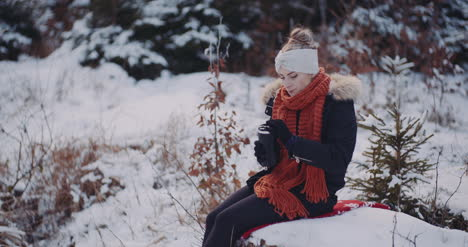 Tourist-Drinking-Coffee-In-Woods-In-Winter-2