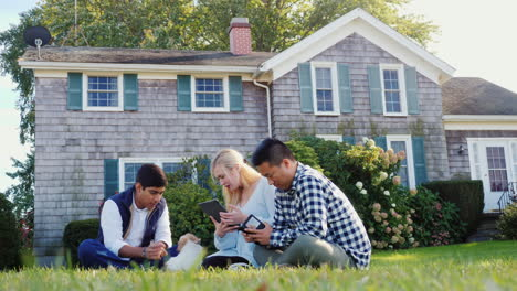 Friends-Use-Technology-With-Puppy-in-Backyard