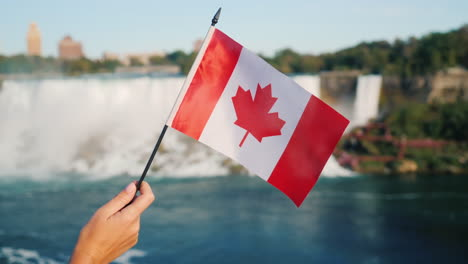 Canadian-Flag-in-Front-of-Niagara-Falls