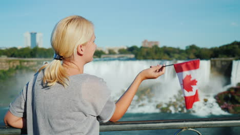 Woman-Waving-Canadian-Flag-by-Niagara-Falls