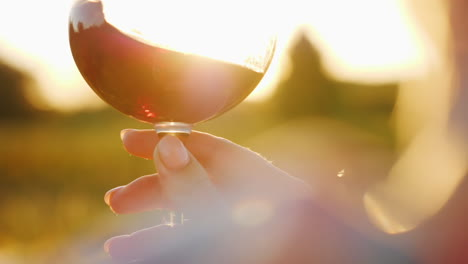 Holding-Wine-Glass-at-Sunset