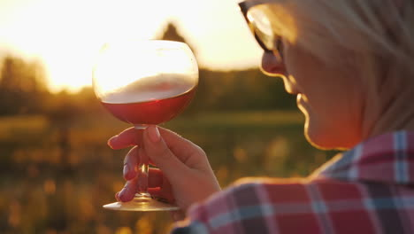 Woman-With-Wine-at-Sunset