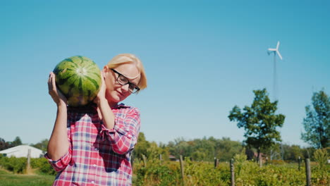Woman-Carrying-Watermelon-on-a-Farm