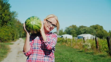 Woman-Carrying-a-Watermelon-on-a-Farm
