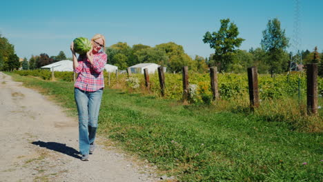 Woman-on-a-Farm-Carrying-Watermelon