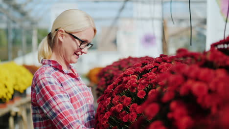 Woman-Admires-Red-Bouquet-of-Flowers