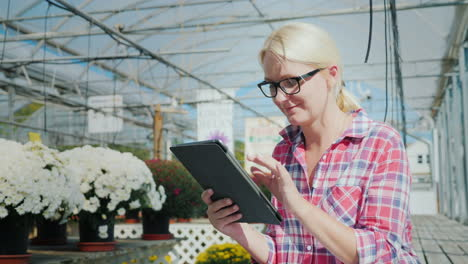 Woman-in-a-Greenhouse-With-a-Tablet