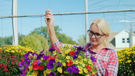 Woman-Carrying-Floral-Hanging-Basket