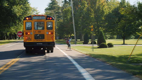 Boy-Gets-Off-Yellow-School-Bus
