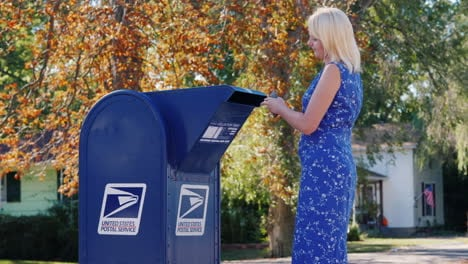 Woman-Posting-Mail-in-USPS-Box