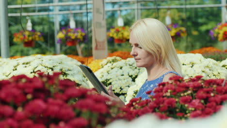 Woman-Using-a-Tablet-in-Plant-Nursery