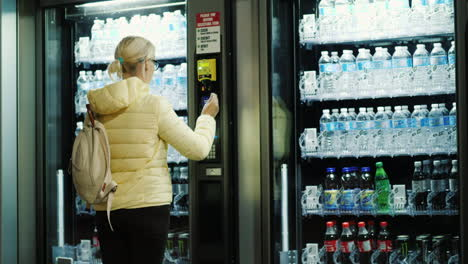 Woman-Buys-Soda-From-Vending-Machine