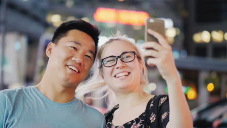 Couple-Take-Selfie-in-City-at-Night