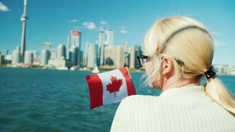 Woman-With-Canadian-Flag-Looks-at-Toronto