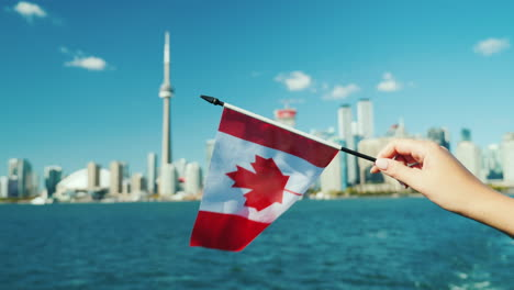 Toronto-and-Hand-Holding-Canadian-Flag
