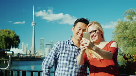 Couple-Take-Selfie-Before-Toronto-Skyline