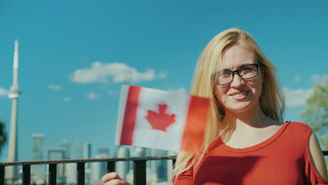 Woman-Waves-Canada-Flag-in-Toronto