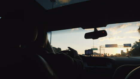 Couple-Driving-at-Sunset