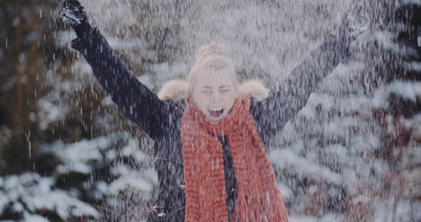 Handful-Of-Snow-Positive-Woman-Throwing-Snow