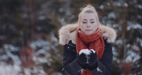 Handful-Of-Snow-Positive-Woman-Throwing-Snow-1