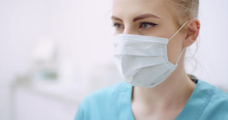 Female-Doctor-Wearing-Protective-Mask-At-Healthcare-Clinic
