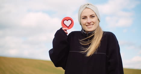 Woman-Holding-Heart-Social-Media-Icon-Loving-Agriculture