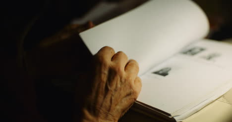 Old-Man-Looking-Through-Documents-At-Desk-At-Night